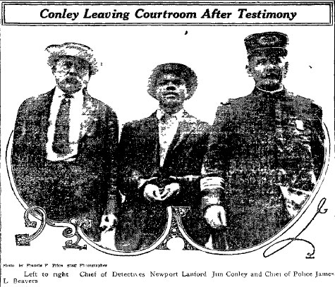 Jim Conley, center, being led away in custody after his testimony
